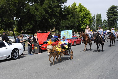 A pony drawn carriage heads up a group of riders with the Blue Lake Saddle Club during the Annie and Mary Day parade in Blue Lake on Sunday.(Hunter Cresswell - The Times-Standard)