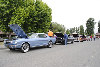 A row of classic cars on Railroad Avenue in Blue Lake on Sunday morning for the Nessler Car Show. (Hunter Cresswell - The Times-Standard)