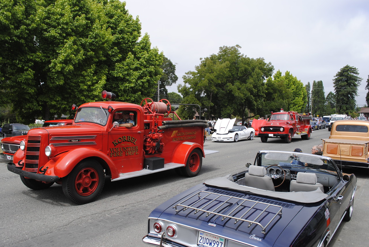 Two classic fire engines from the Korbel Volunteer Fire Department in the Annie and Mary Day parade in Blue Lake on Sunday. (Hunter Cresswell - The Times-Standard)