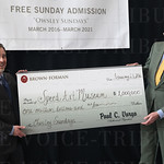 Speed Art Museum CEO, Ghislain d\'Humiéres and Brown-Forman Vice Chairman, Jim Welch both smiled for the media while displaying a replica $1,000,000 donation check.