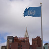 UN flag with the Chrysler Building in the background.