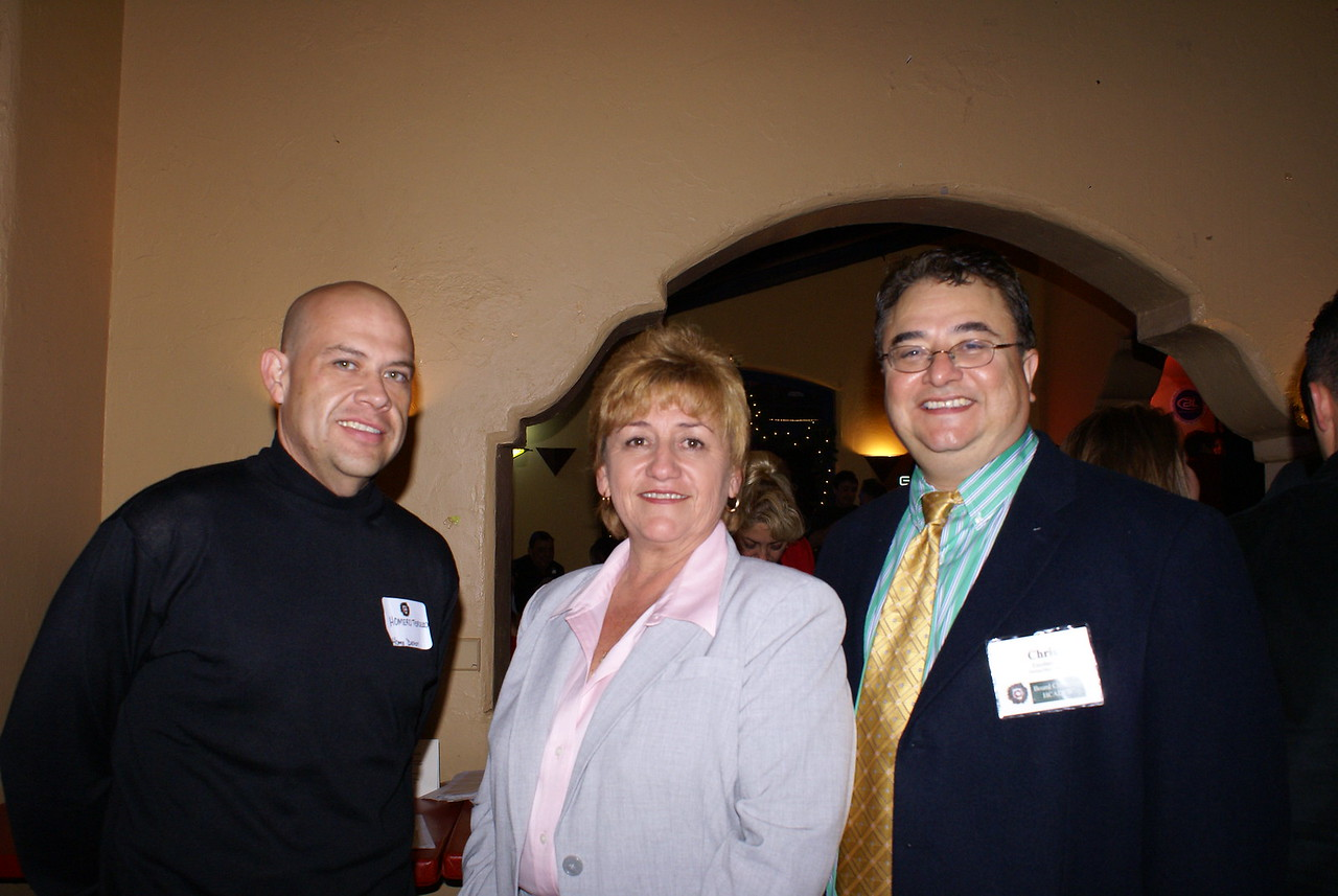 Gloria Hernandez and Homer Tercero with Home Depot and Chris Escobedo, HCADFW Board Chairman (Phillips/May Corp)