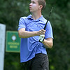The annual Lowell City Junior Golf Tournament took place on Monday at Long Meadow Golf Club. Watching his tee shot is Kevin Carpenter, 14, of Tyngsboro. SUN/JOHN LOVE