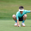 The annual Lowell City Junior Golf Tournament took place on Monday at Long Meadow Golf Club. Dylan Kuczek, 12, of Lowell gets ready for one of his putts during the tournament. SUN/JOHN LOVE