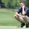 The annual Lowell City Junior Golf Tournament took place on Monday at Long Meadow Golf Club. Ben McKay, 17, of Tewksbury looks over the green as he wait to putt during the tournament. SUN/JOHN LOVE