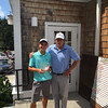 Eric Roy, left, holds the trophy after capturing the boys 16-18 championship next to Long Meadow pro Gene Manley. SUN/CARMINE FRONGILLO