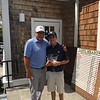 Mikey Yfantopoulos poses with Long Meadow pro Gene Manley after winning the boys 15-under title on Monday afternoon. SUN/CARMINE FRONGILLO