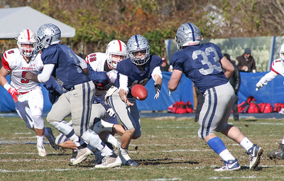 no.12, Ryan O'Leary passing to no.33, Canyon Birch. Manasquan High School v/s Wall High School's annual Thanksgiving day game in Manasquan, NJ on 11/22/18. [DANIELLA HEMINGHAUS | THE COAST STAR]