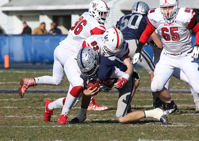 Wall no.83, Tanner Powers tackling Manasquan no.12, Ryan O'Leary. Manasquan High School v/s Wall High School's annual Thanksgiving day game in Manasquan, NJ on 11/22/18. [DANIELLA HEMINGHAUS | THE COAST STAR]
