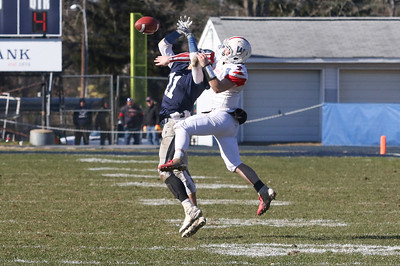Wall's no.7, Dylan Richey blocking Manasquan's no.11, James Pendergist from catching the ball. Manasquan High School v/s Wall High School's annual Thanksgiving day game in Manasquan, NJ on 11/22/18. [DANIELLA HEMINGHAUS | THE COAST STAR]