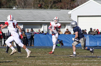 no.7, Dylan Richey passing to no.5, Charlie Sasso. Manasquan High School v/s Wall High School's annual Thanksgiving day game in Manasquan, NJ on 11/22/18. [DANIELLA HEMINGHAUS | THE COAST STAR]