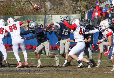 Wall no.65, Jack Wolter trying to block Manasquan's no.12, Ryan O'Leary's pass. Manasquan High School v/s Wall High School's annual Thanksgiving day game in Manasquan, NJ on 11/22/18. [DANIELLA HEMINGHAUS | THE COAST STAR]
