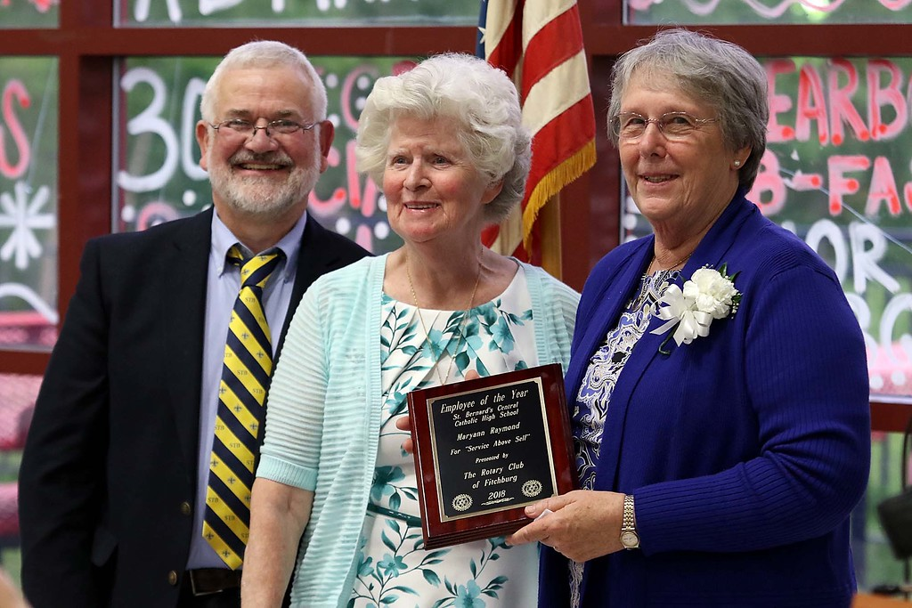 . The annual Rotary Awards Dinner was held at Fitchburg High School on Tuesday night by Fitchburg and Fitchburg East Rotary Clubs. Employee of the year at St. Bernard\'s Central Catholic High School is Maryann Raymond, right, with Principal Robert Blanchard, and awards dinner Chairman Mary Whitney. SENTINEL & ENTERPRISE/JOHN LOVE