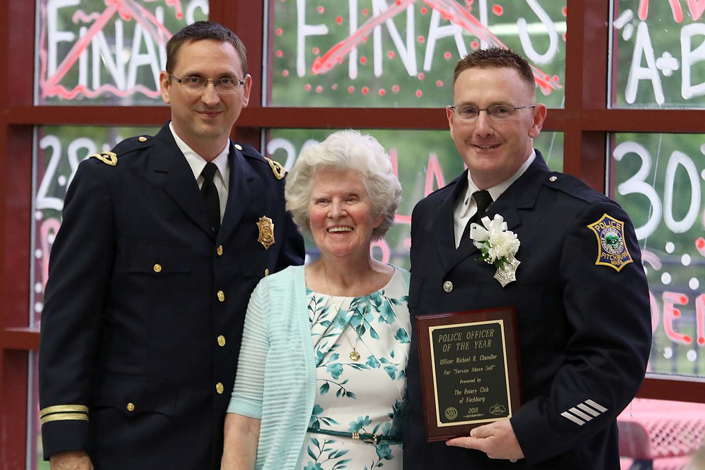 . The annual Rotary Awards Dinner was held at Fitchburg High School on Tuesday night by Fitchburg and Fitchburg East Rotary Clubs. Fitchburg Police Officer of the Year is Officer  Michael Chandler, right, with Capt. Steven Giannini and Awards Dinner Chairman Mary Whitney. SENTINEL & ENTERPRISE/JOHN LOVE