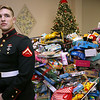 State Rep. Jim Arciero held his annual Sun Santa/Toys for Tots fundraiser at the Franco American Club in Westford on Thursday night, December 7, 2017. Marine Lance Corporal Justin Lanequaley guarded the toys that wher coming in for the Toys for Tots drive at the event. SUN/JOHN LOVE