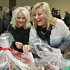 State Rep. Jim Arciero held his annual Sun Santa/Toys for Tots fundraiser at the Franco American Club in Westford on Thursday night, December 7, 2017. Stacey Clement and Darcy Clements of Elite Hair Design in Westford had a lot of fun looking over the baskets at the event. SUN/JOHN LOVE