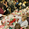 State Rep. Jim Arciero held his annual Sun Santa/Toys for Tots fundraiser at the Franco American Club in Westford on Thursday night, December 7, 2017. Many filled around the table of baskets trying to pick the right one during the event. SUN/JOHN LOVE