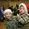 State Rep. Jim Arciero held his annual Sun Santa/Toys for Tots fundraiser at the Franco American Club in Westford on Thursday night, December 7, 2017. Isabella Palmer, 10, of Westford and D.J. Kobalchek, 2, of New Ipswich got into the holiday spirit with Santa hats. SUN/JOHN LOVE