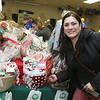 State Rep. Jim Arciero held his annual Sun Santa/Toys for Tots fundraiser at the Franco American Club in Westford on Thursday night, December 7, 2017. Jessica Glisczeski the manager of Villa Mexicanna of Acton show off the basket she donated to the event. SUN/JOHN LOVE
