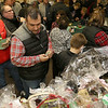 State Rep. Jim Arciero held his annual Sun Santa/Toys for Tots fundraiser at the Franco American Club in Westford on Thursday night, December 7, 2017. Ray Lareau of Westford looks over the baskets and tries to see which one he wanted to try and win. SUN/JOHN LOVE