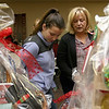 State Rep. Jim Arciero held his annual Sun Santa/Toys for Tots fundraiser at the Franco American Club in Westford on Thursday night, December 7, 2017. Alexys Flanders of Pepperell and and Denise Lupien of Salisbury look over some of the many baskets in the raffle. SUN/JOHN LOVE