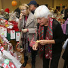 State Rep. Jim Arciero held his annual Sun Santa/Toys for Tots fundraiser at the Franco American Club in Westford on Thursday night, December 7, 2017. Looking over the baskets wondering what to try and win is Sue Collins and Donna Groom both of Westford. SUN/JOHN LOVE