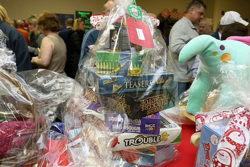 State Rep. Jim Arciero held his annual Sun Santa/Toys for Tots fundraiser at the Franco American Club in Westford on Thursday night, December 7, 2017. This basket was full of board games. SUN/JOHN LOVE
