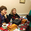 State Rep. Jim Arciero held his annual Sun Santa/Toys for Tots fundraiser at the Franco American Club in Westford on Thursday night, December 7, 2017. Talking to people  as they came into by tickets at the event was Gwen Regan and Sandy Collins. SUN/JOHN LOVE