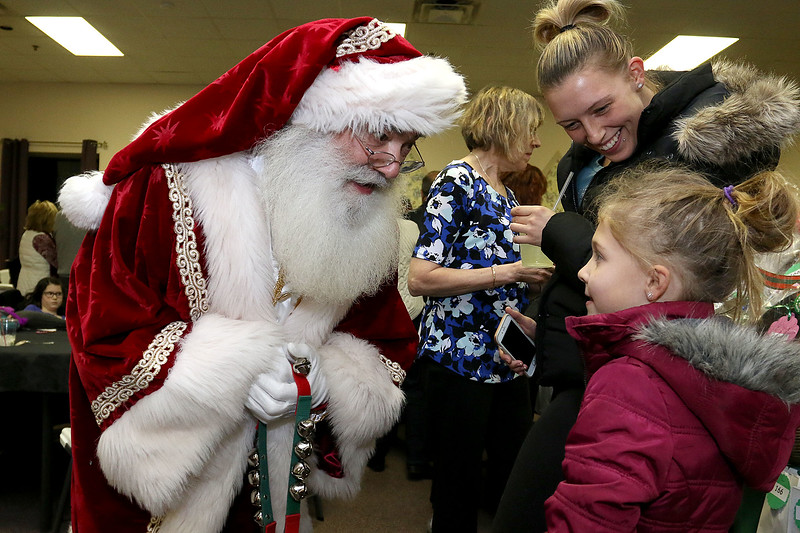 State Rep. Jim Arciero held his annual Sun Santa/Toys for Tots fundraiser at the Franco American Club in Westford on Thursday night, December 7, 2017. Santa Claus, aka Greg Narinaian, visited and Jaidyn Kimpland, 6, and her mom Tiffany Defeo of Ayer got to chat with him for a bit. SUN/JOHN LOVE