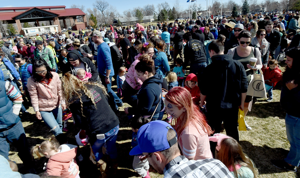 . The kids and parents in the 3 and under group collect eggsduring the 8th Annual White Fields Community Church Easter Egg Hunt at Roosevelt Park in Longmont on Saturday. Cliff Grassmick  Photographer  March 31, 2018