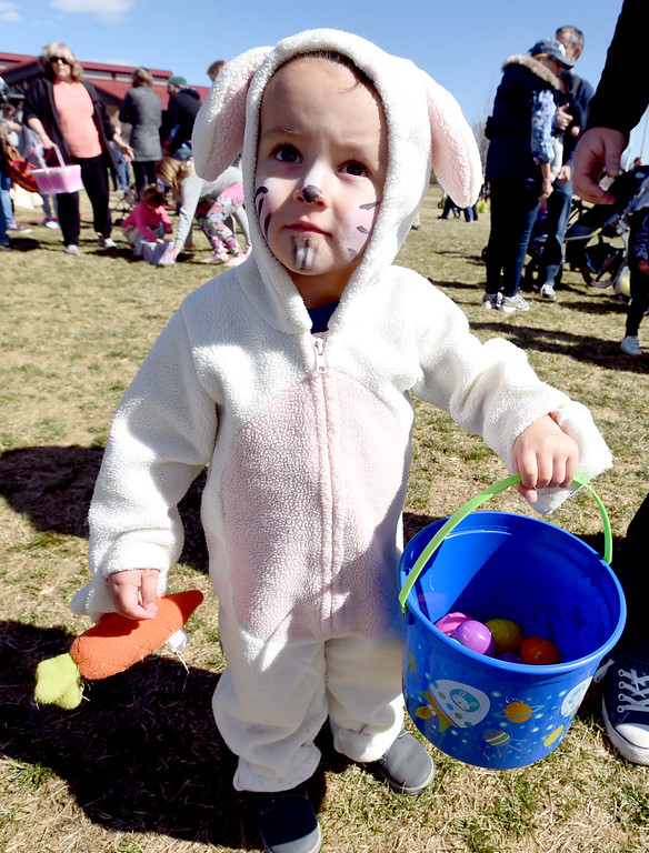 . Dillon Reed, 2, comes out of the egg scrum with plenty of eggs at the 8th Annual White Fields Community Church Easter Egg Hunt at Roosevelt Park in Longmont on Saturday. Cliff Grassmick  Photographer  March 31, 2018