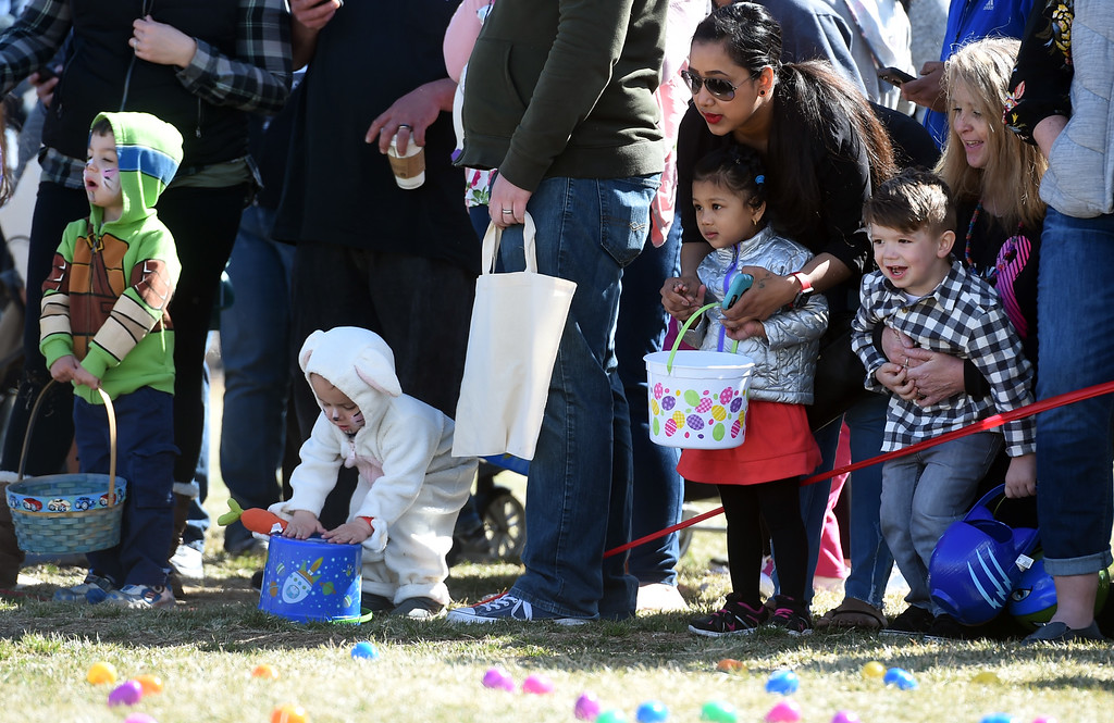 . The 3 and under kids are more than ready to go during the 8th Annual White Fields Community Church Easter Egg Hunt at Roosevelt Park in Longmont on Saturday. Cliff Grassmick  Photographer  March 31, 2018
