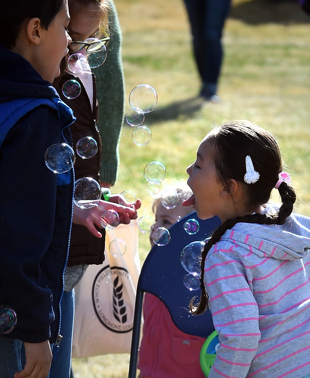 . Rosalia Toro, 4, is acquiring a taste for bubbles during the 8th Annual White Fields Community Church Easter Egg Hunt at Roosevelt Park in Longmont on Saturday. Cliff Grassmick  Photographer  March 31, 2018