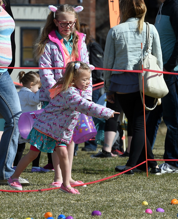 . Memphis Marchese, 3, points out the eggs she wants during the 8th Annual White Fields Community Church Easter Egg Hunt at Roosevelt Park in Longmont on Saturday. Cliff Grassmick  Photographer  March 31, 2018