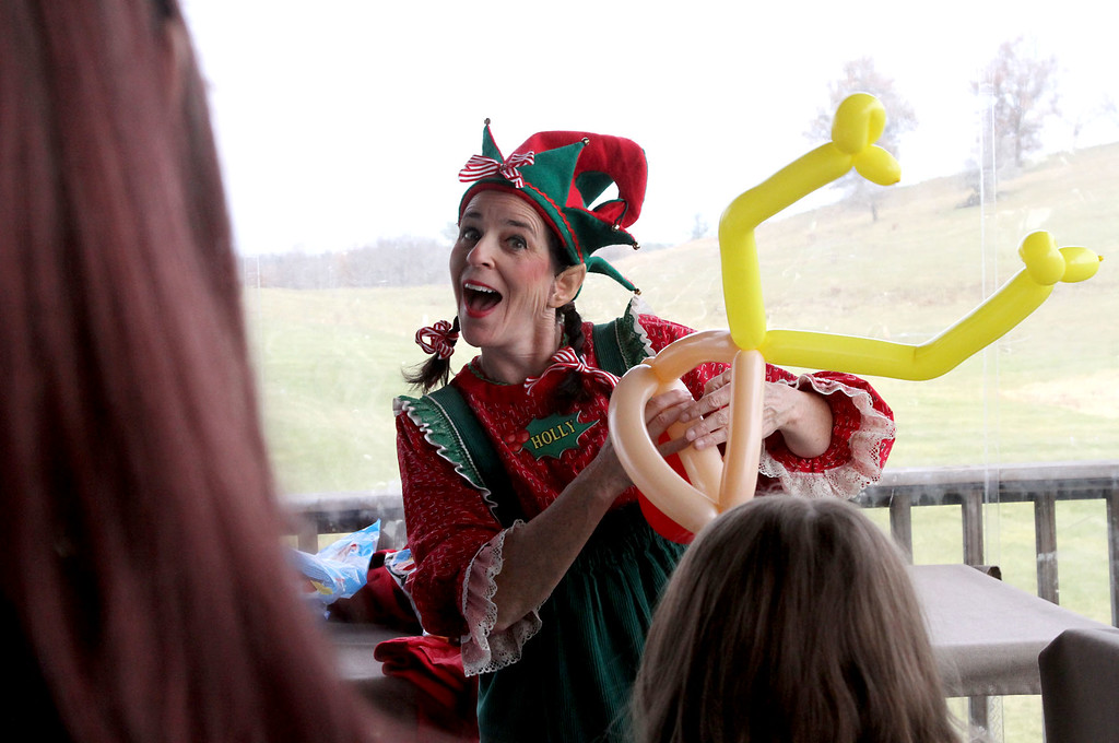 ". Making balloon art at the annual holiday party for area shelters at Gibbet Hill in Groton is ""Holly The Elf\"" aka: Nicole Portwood. SUN/David H. Brow"