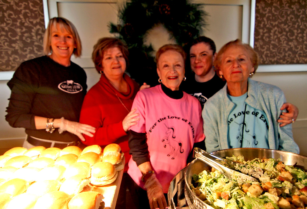 . Gibbet Hill staff and volunteers at the annual holiday party for folks from area shelters, L-R, Karen Carr, Martine Paim, Elaine Goodman, Kristen Donahue and Marilyn Frank. SUN/David H. Brow