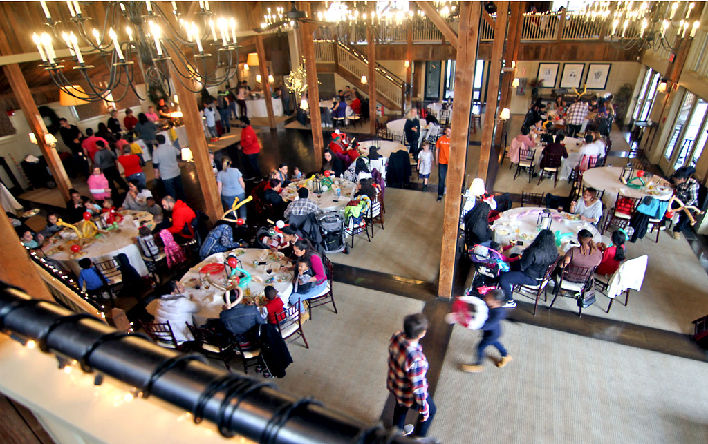 . Overview of the annual holiday party for folks from area shelters held at Gibbet Hill in Groton. SUN/David H. Brow