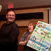 "Al Vukasin and Tracy DuFresne (Altana FCU) share a laugh over the ""multi media masterpiece"" Tracy's holding."