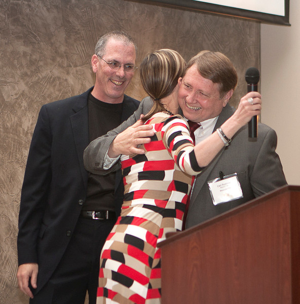 Carl Rummel. Missoula FCU Board Chair is the Mitch Reed Volunteer of the Year for 2013. Here he's being congratulated by Tom Boos and Tracie Kenyon.