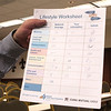 "A participant, who just finished the hands-on portion of the Retirement Fair, shows off his completed ""Lifestyle Worksheet."""