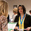 "Michelle Johnson, MCUN Board Member and Wolf Point FCU Manager, concentrates at the Food and Clothing ""lifestyle consideration"" table."