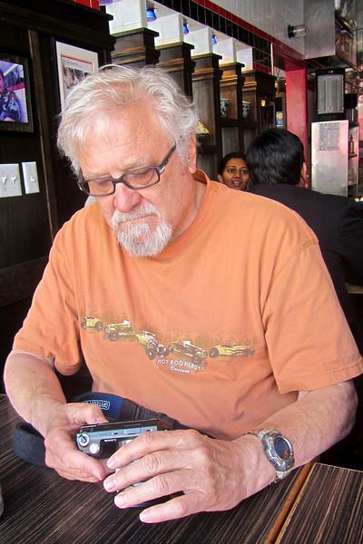Keith playing with camera at Nanking in San Francisco