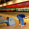Old man trying to bowl
