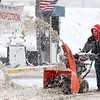 Another storm hit the north central region on Tuesday less then a week after the last storm that dropped 18+ inches on the region. Chris Paine an employee at Johnny's Service Station and Convenience Store on River Street works on snow plowing the snow out of the way for customers.  SENTINEL & ENTERPRISE/JOHN LOVE