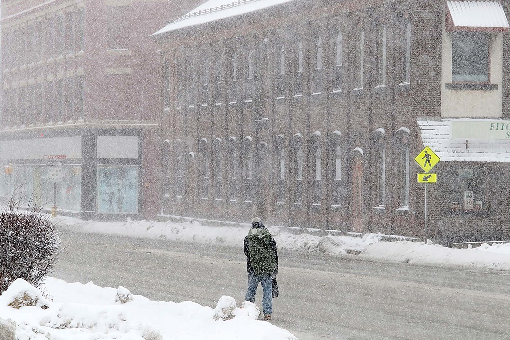 . Another storm hit the north central region on Tuesday less then a week after the last storm that dropped 18+ inches on the region. A pedestrian makes his way down Main Street in Fitchburg during the storm. SENTINEL & ENTERPRISE/JOHN LOVE