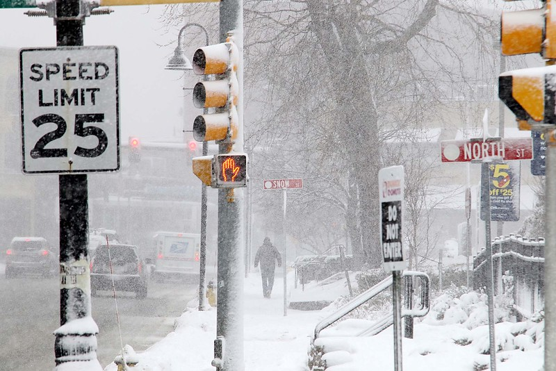 Another storm hit the north central region on Tuesday less then a week after the last storm that dropped 18+ inches on the region. A pedestrian makes his way down the sidewalk on Main Street in Fitchburg as the storm picked up around 12:30 p.m. SENTINEL & ENTERPRISE/JOHN LOVE