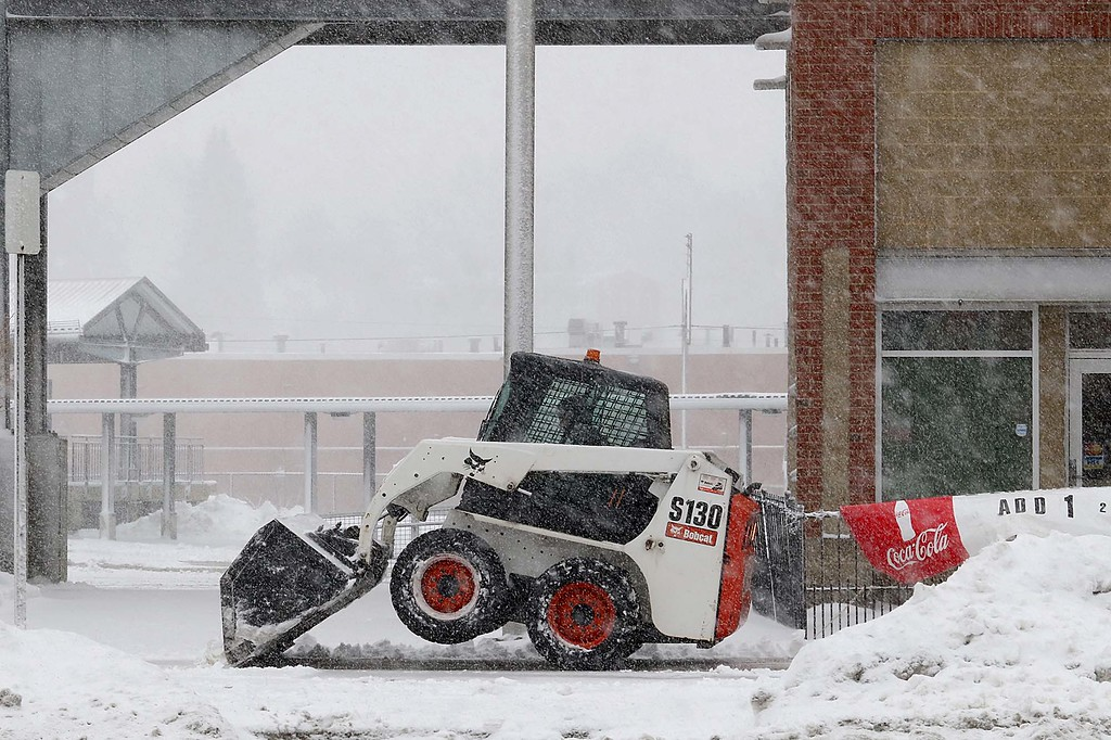 . Another storm hit the north central region on Tuesday less then a week after the last storm that dropped 18+ inches on the region. This bobcat  had to be off it\'s front tires to plow in front of Super Fans on Main Street in Fitchburg SENTINEL & ENTERPRISE/JOHN LOVE
