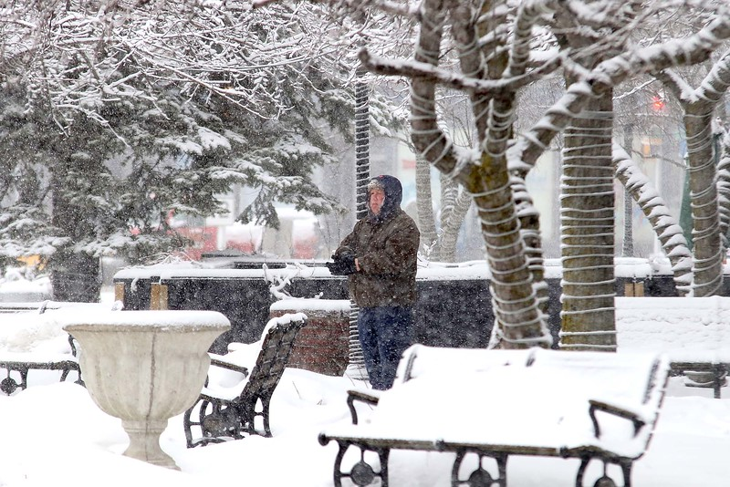 Another storm hit the north central region on Tuesday less then a week after the last storm that dropped 18+ inches on the region. A pedestrian stops for a moment in front of Rye & Thyme in Leominster in Monument Square, during the storm. SENTINEL & ENTERPRISE/JOHN LOVE