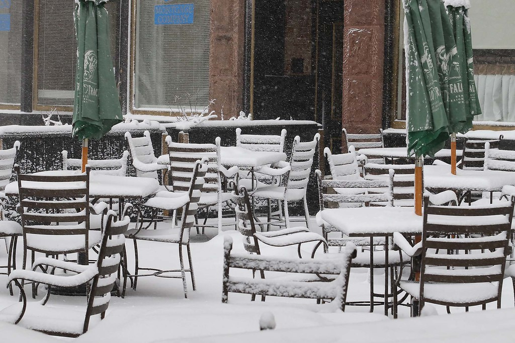 . Another storm hit the north central region on Tuesday less then a week after the last storm that dropped 18+ inches on the region. The chairs and tables at the outdoor patio at  Rye & Thyme in Leominster were covered in snow as the storm raged on. SENTINEL & ENTERPRISE/JOHN LOVE