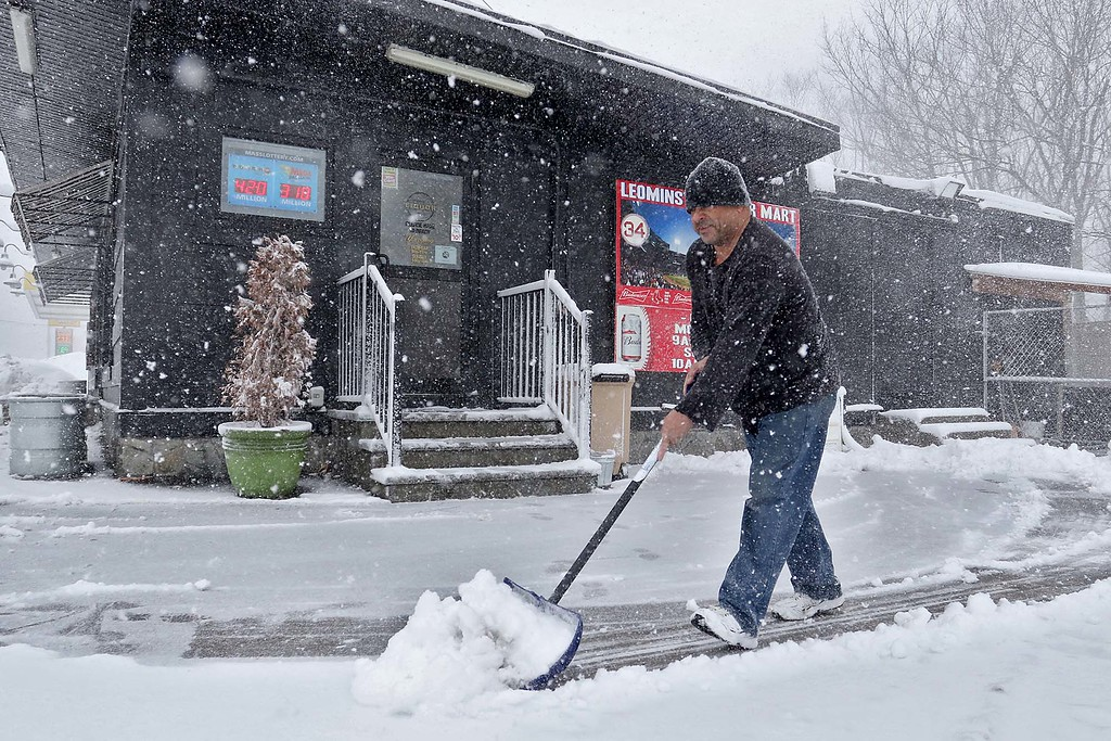 . Another storm hit the north central region on Tuesday less then a week after the last storm that dropped 18+ inches on the region. Andre Santhez and employee at Leominster liquor mart on North Main Street works on keeping the snow cleared for customers as the storm started to get worse around 1 p.m. SENTINEL & ENTERPRISE/JOHN LOVE